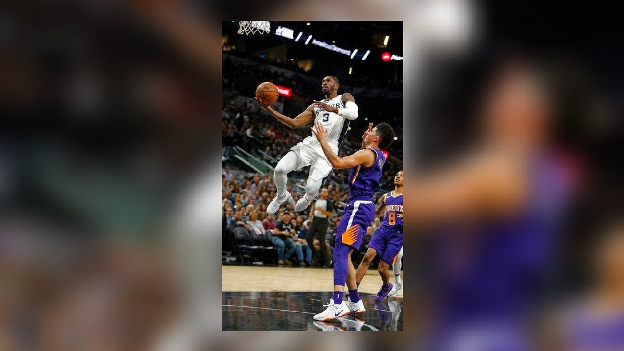 After a steal San Antonio Spurs' Brandon Paul(3) drives for two as Phoenix Suns Devin Booker watches in a NBA game on Sunday, Nov. 5, 2017 in San Antonio. (Source: AP Photo/Ronald Cortes)