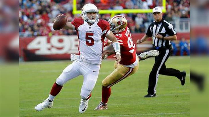 Arizona Cardinals quarterback Drew Stanton (5) scrambles from San Francisco 49ers defensive end DeForest Buckner (99) during the second half of an NFL football game in Santa Clara, Calif., Sunday, Nov. 5, 2017. (Source: AP Photo/Marcio Jose Sanchez)