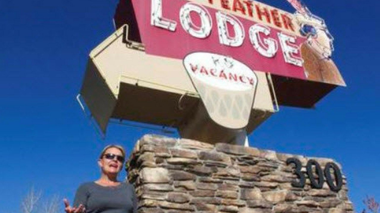 In this photo, Clarinda Vail stands outside the lodge her family owns in Tusayan, Ariz.. Vail opposes a ballot measure to increase building heights in the small town outside the Grand Canyon's South Rim entrance. (Source: AP Photo/Felicia Fonseca)