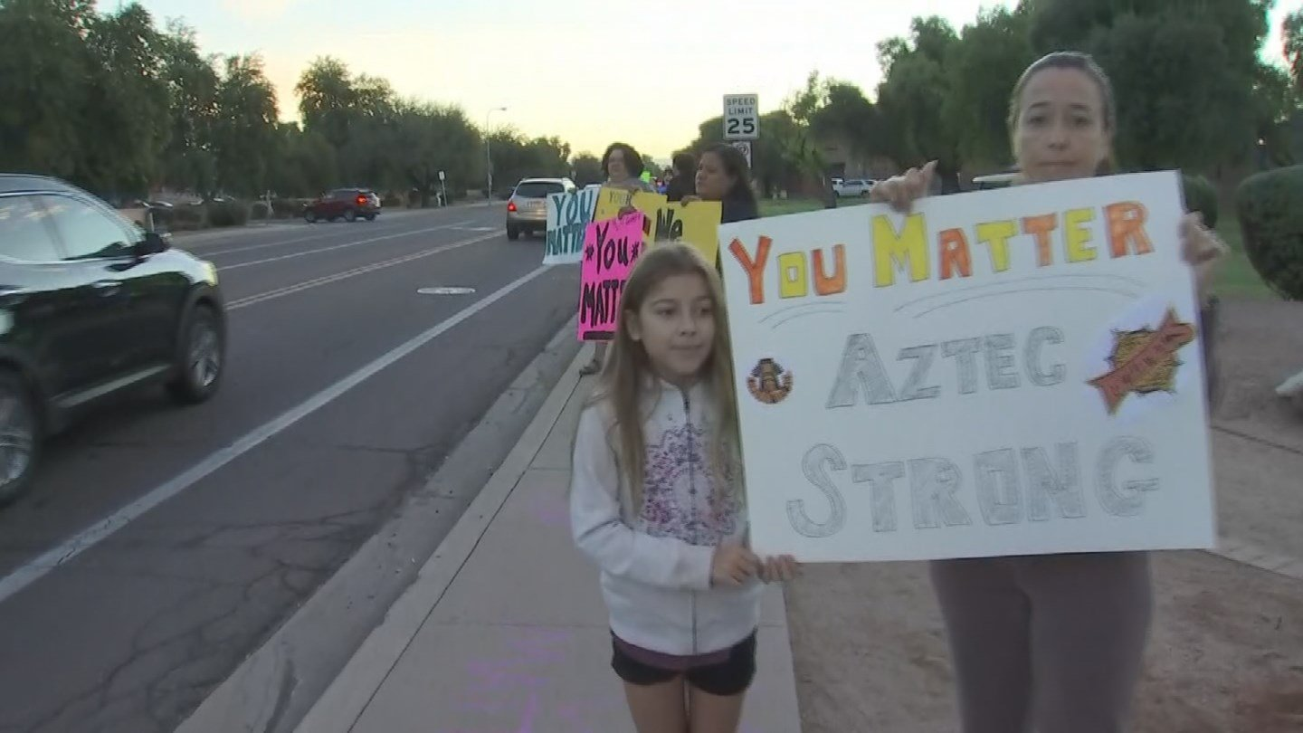 """Parents, friends and community members gathered outside of Corona Del Sol showing the school community that they were there for them with signs that read """"You Matter"""", """"We Care"""", """"You are important"""" and """"You are not alone."""" (Source: 3TV/CBS 5)"""