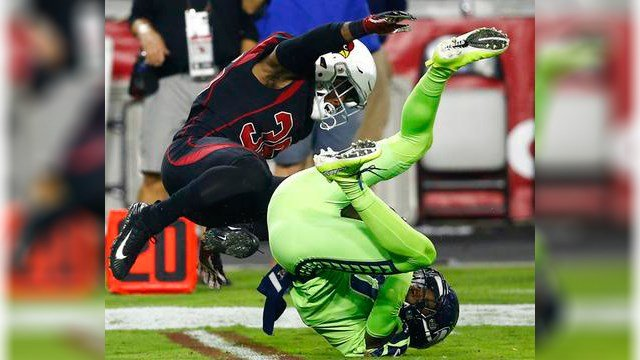 Seattle Seahawks wide receiver Paul Richardson makes the catch as Arizona Cardinals safety Budda Baker, left, defends during the first half of an NFL football game, Thursday, Nov. 9, 2017, in Glendale, Ariz. (Source: AP Photo/Ross D. Franklin)