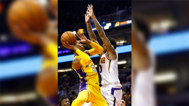 Los Angeles Lakers guard Jordan Clarkson (6) drives to the hoop against Phoenix Suns forward Marquese Chriss (0) during the first half of an NBA basketball game Monday, Nov. 13, 2017, in Phoenix. (Source: AP Photo/Ross D. Franklin)