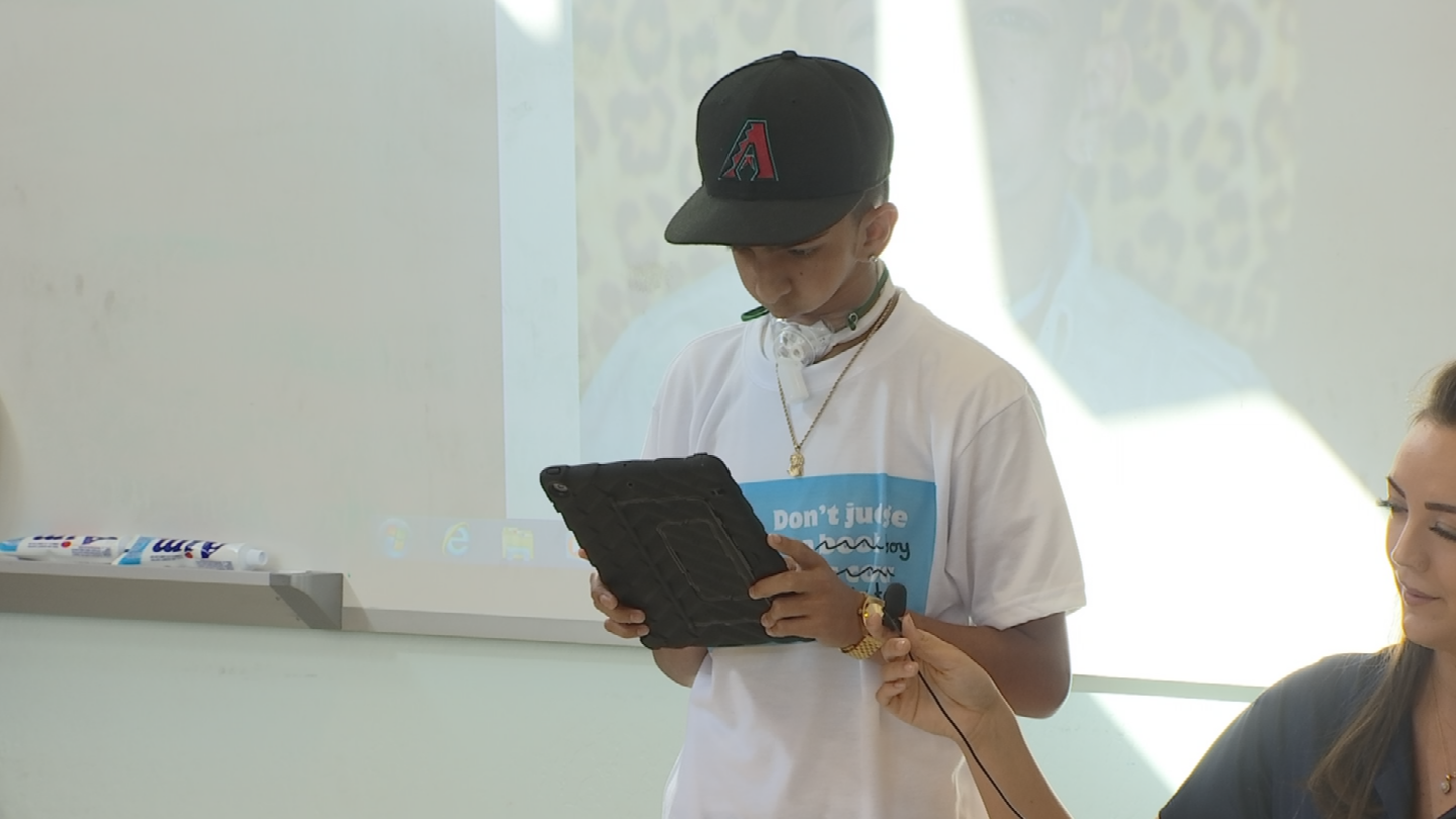 Isaiah Costa communicates through tablets and cell phones and talked to the students as well. (Source: 3TV/CBS 5)