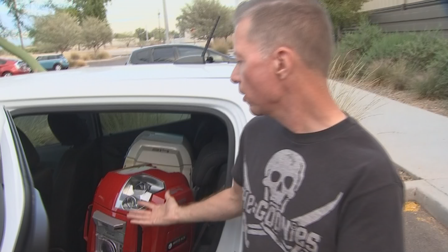 Tom Burick with Hacienda HealthCare arrived in time to remove his thousands of dollars worth of robots but is worried about the future of his program. (Source: 3TV/CBS 5)