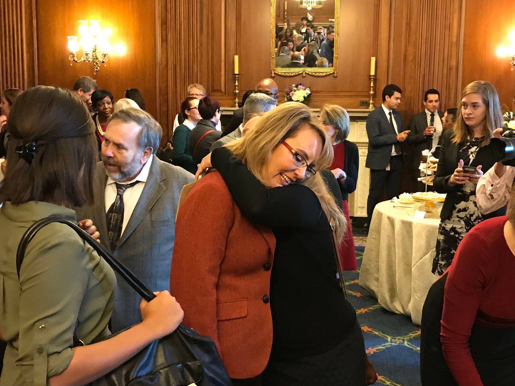 Former Arizona Rep. Gabrielle Giffords gets a hug from a well-wisher after an event to name a room at the U.S. Capitol in honor of her and the late California Rep. Leo J. Ryan Jr. (Photo by Trevor Fay/Cronkite News)
