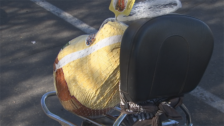 The motorcyclists strapped turkeys to their bikes and then delivered them (Source: 3TV/CBS 5)