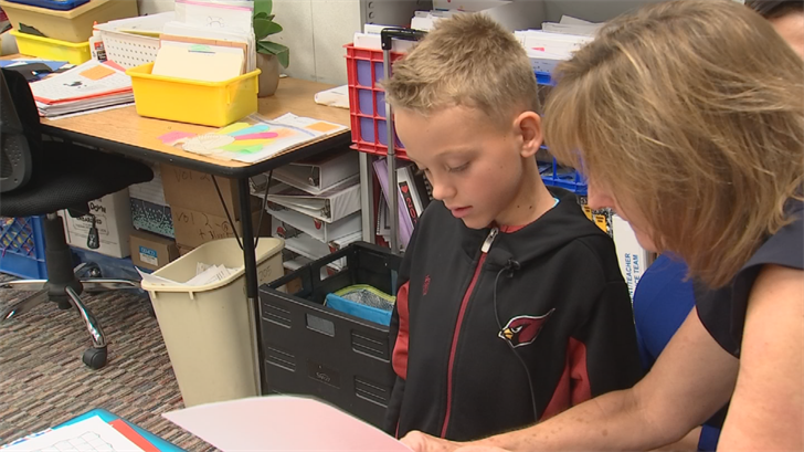 Holtzen's student, Hayden, showed everyone his reading skills as he shared the letter he wrote to the Silver Apple Committee. (Source: 3TV)