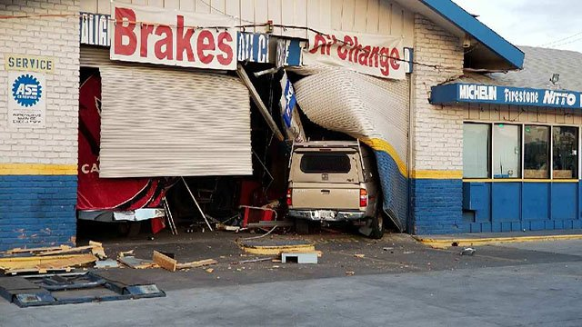 A truck crashed into an auto repair shop early Tuesday morning in Phoenix. (Source: 3TV/CBS 5)