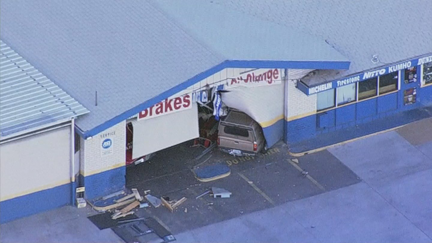 According to police, the driver had a medical emergency when the truck drove onto the sidewalk and into the auto repair shop. (Source: 3TV/CBS 5)