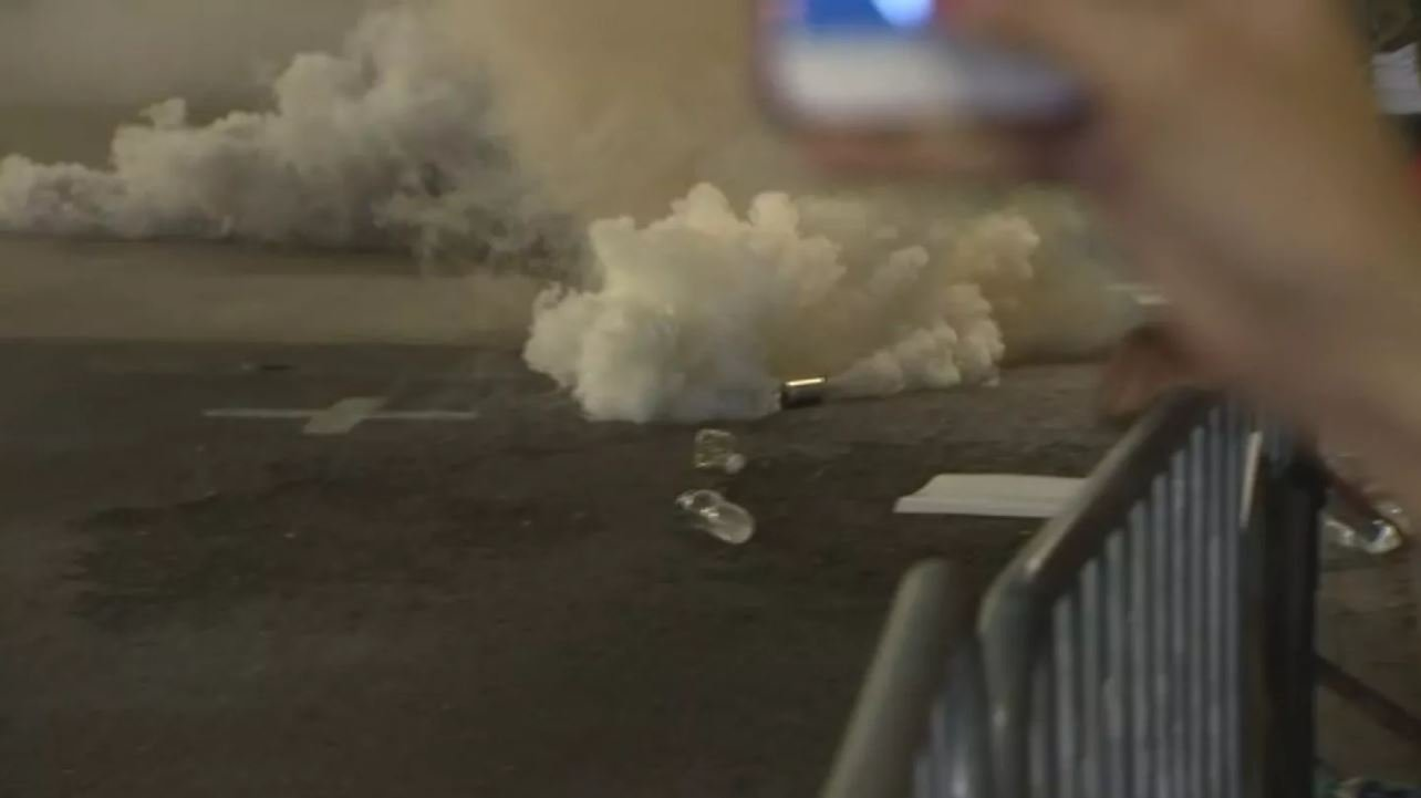 Gas billowing from a canister in the street during a Trump protest is downtown Phoenix on Aug. 22. (Source: 3TV/CBS 5)