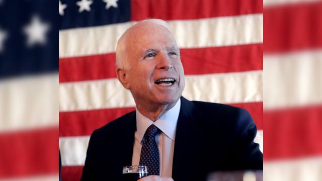 U.S. Sen. John McCain, R-Ariz., raises a glass after touring the Wren House Brewery, Tuesday, Nov. 1, 2016 in Phoenix. (Source: AP Photo/Matt York)