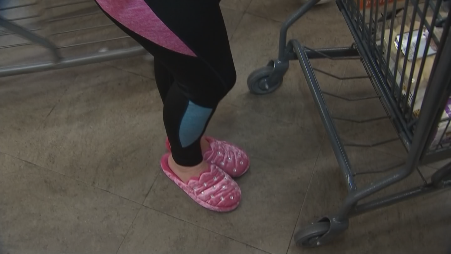 Shopper Caroline Slade opted for her pink fuzzy slippers. (Source: 3TV/CBS 5)