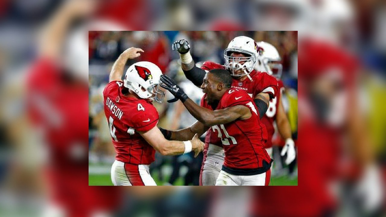 Arizona Cardinals kicker Phil Dawson (4) celebrates his game winning 57-yard field goal during the second half of an NFL football game against the Jacksonville Jaguars with cornerback Patrick Peterson (21). (Source: The Associated Press)