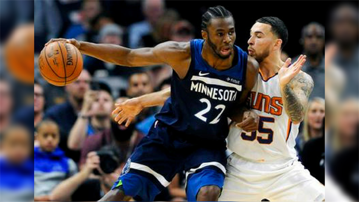 Phoenix Suns' Mike James (55) guards against Minnesota Timberwolves' Andrew Wiggins (22) during the second quarter of an NBA basketball game on Sunday, Nov. 26, 2017, in Minneapolis. (Source: AP Photo/Hannah Foslien)