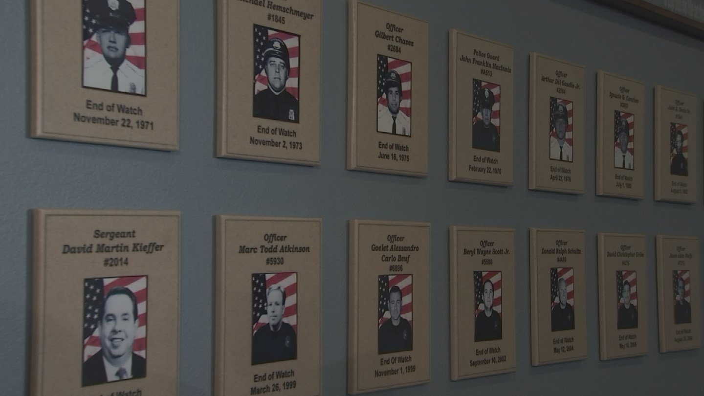 The pictures of fallen officers on the wall of honor. 27 Nov. 2017 (Source: 3TV/CBS 5 News)