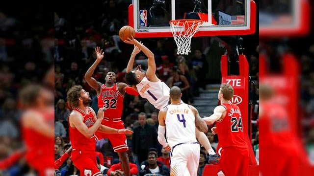 Booker scored 33 points, and the Phoenix Suns held off the Chicago Bulls for a 104-99 win on Tuesday night. (Source: AP Images)