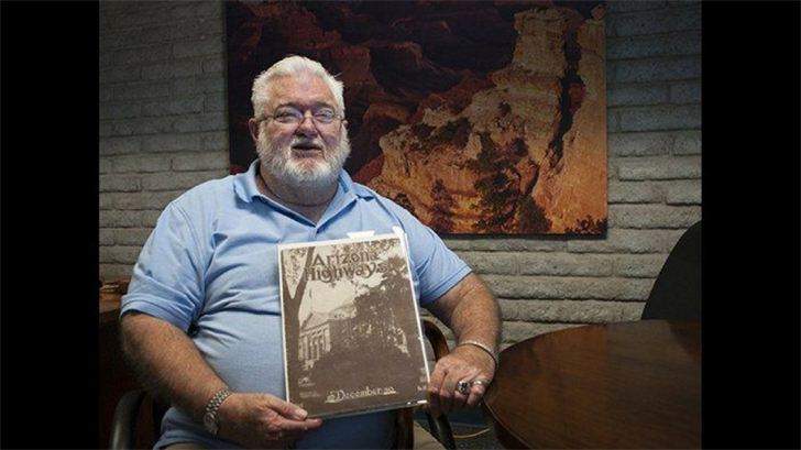 Dennis Chandler with the December 1930 edition of Arizona Highways Magazine.(Source: Arizona Department of Transportation)