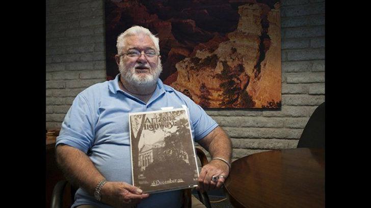 Dennis Chandler with the December 1930 edition of Arizona Highways Magazine.(Source: Arizona Department of Transportation)