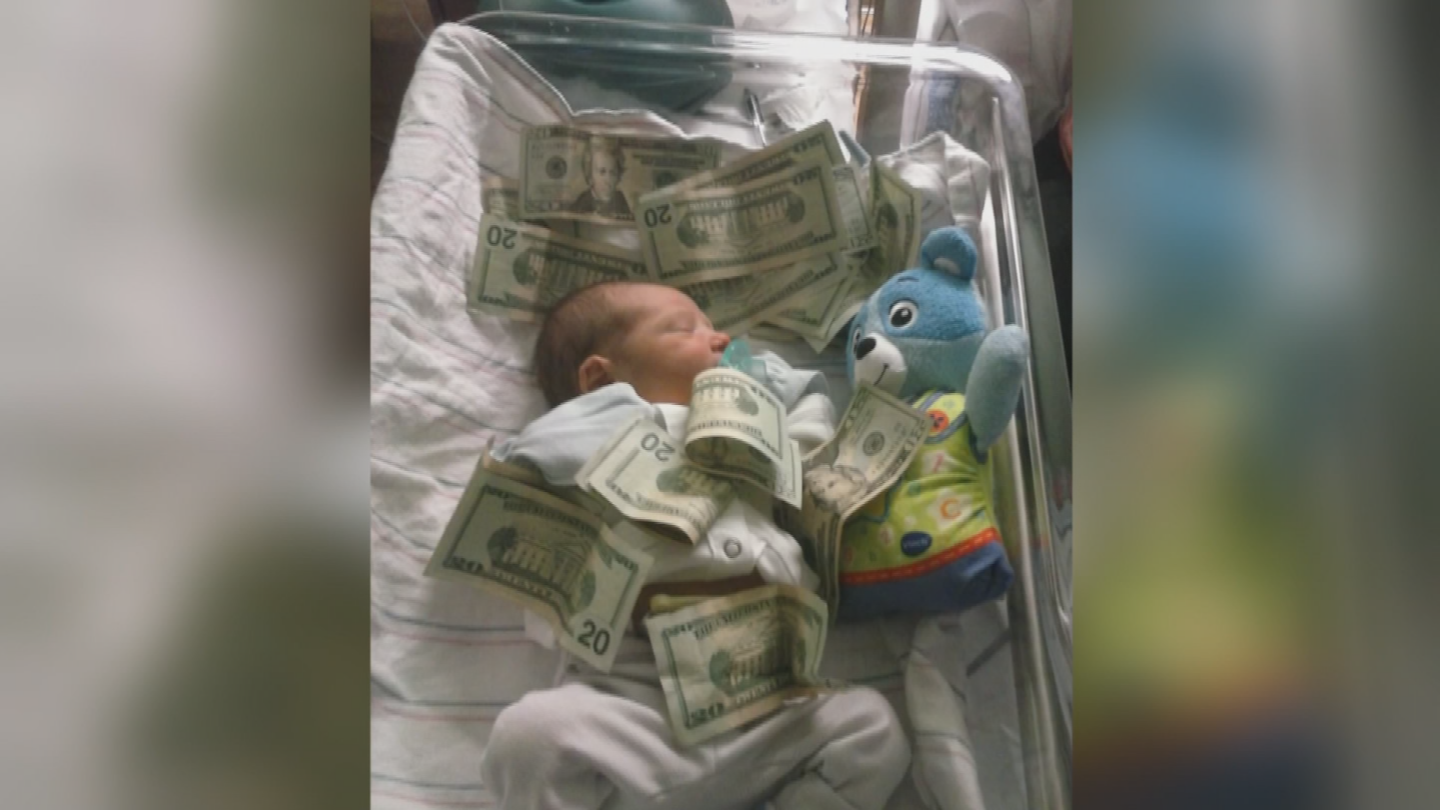 The card was filled with photos of a man holding a newborn baby and other images of the baby lying in a crib. (Source: 3TV/CBS 5)