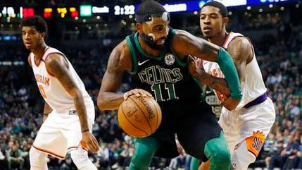Boston Celtics' Kyrie Irving (11) looks to move against Phoenix Suns' Tyler Ulis right, during the third quarter of an NBA basketball game in Boston, Saturday, Dec. 2, 2017. The Celtics won 116-111. (Source: AP Photo/Michael Dwyer)
