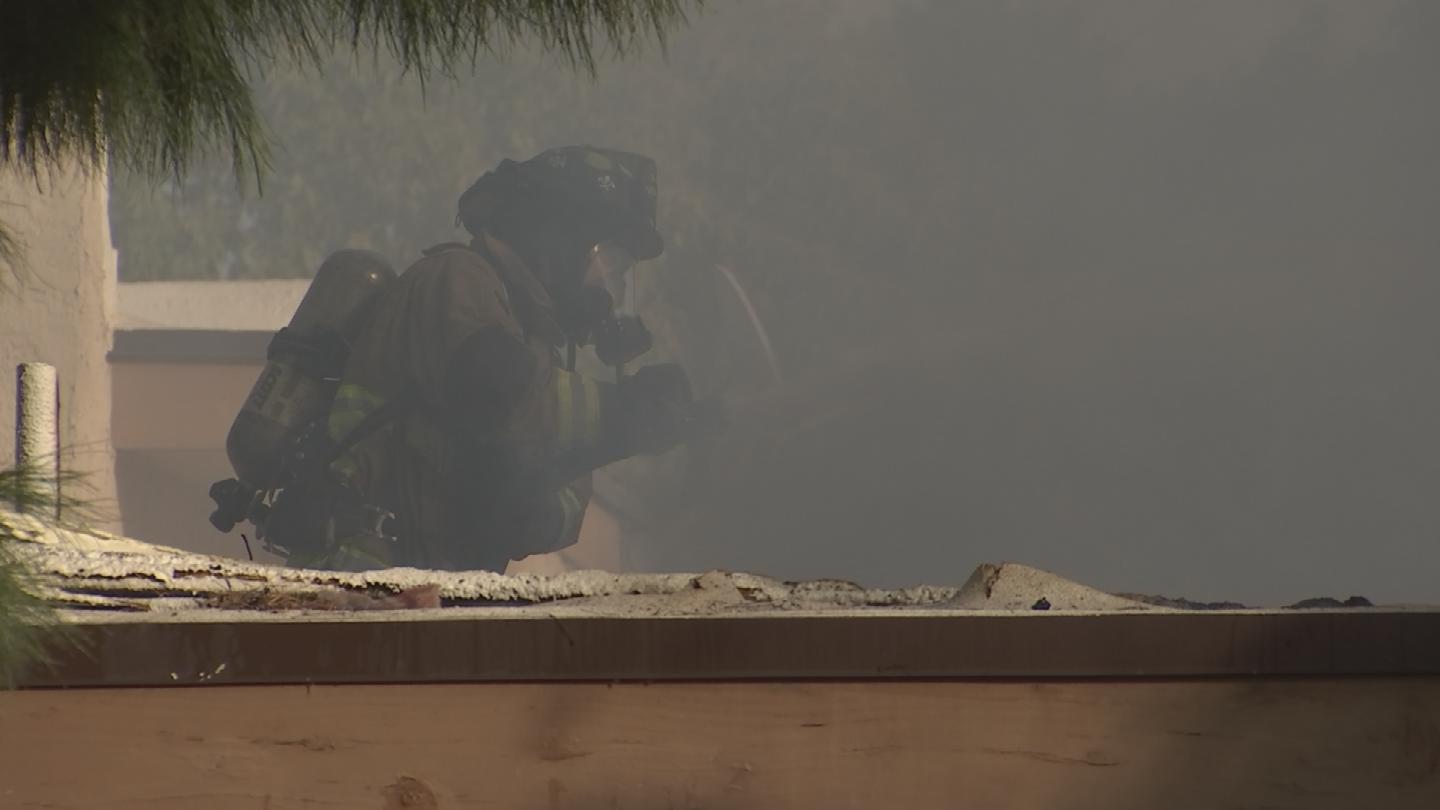 Firefighters battled the fire from the roof. (Source: 3TV/CBS 5)