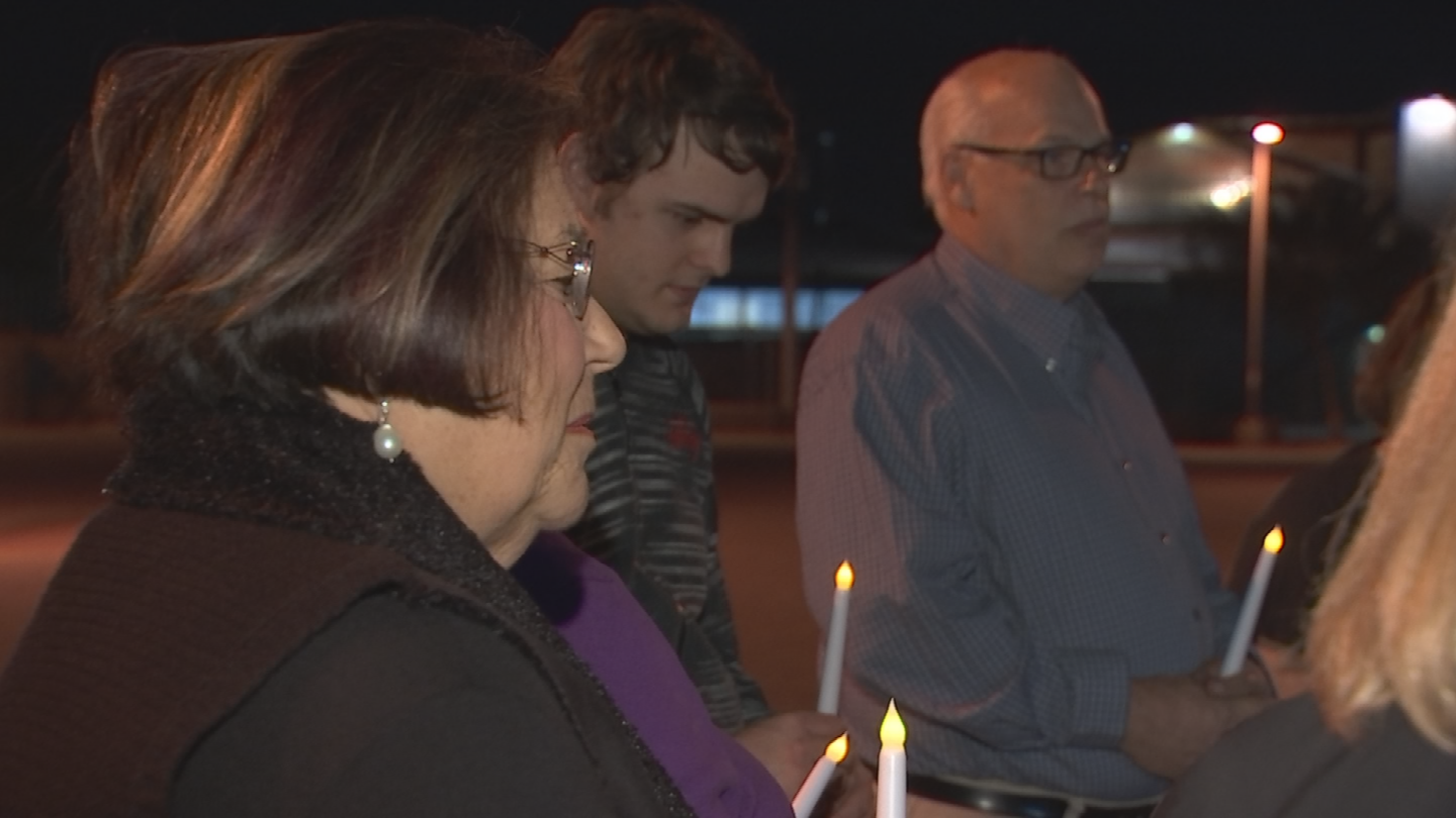 Vigil attendees held fake candles while remembering the victims. (Source: 3TV/CBS 5)