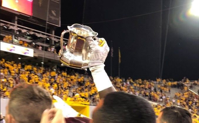 Players were seen celebrating with a trophy after the big Saturday night win, however, that trophy is a replica. (Source: 3TV/CBS 5)
