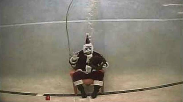 Scuba Professionals of Arizona is offering a unique twist on the holiday classic photo, allowing parents and children to suit up in scuba gear and get into the water for an underwater photo with Santa. (Source: 3TV/CBS 5)