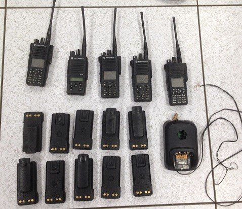 Agents found five Motorola 2-way radios, 10 Motorola batteries, one Motorola charger, eight cellphones and one auxiliary cellphone charger. (Source: U.S. Customs and Border Protection)
