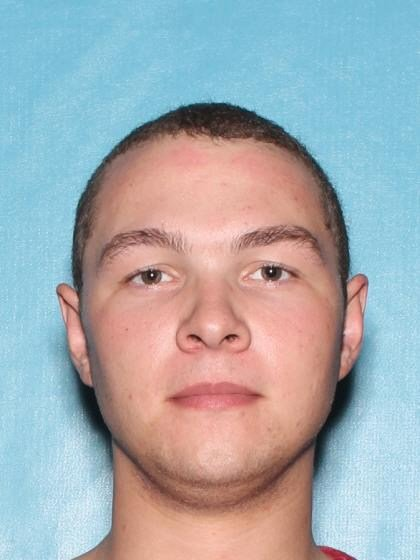 Driver's license photo of Adam Coleman, 20, arrested in connection to a Peoria arson and drive-by shooting. (Source: Peoria Police Department)