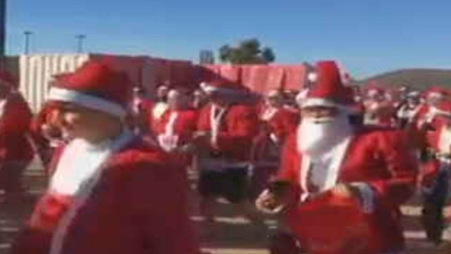 Hundreds of Santas came out for a charity run. (Source: 3TV/CBS 5)