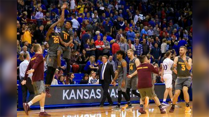 Arizona State forward Romello White (23) and guard Shannon Evans II (11) celebrate after an NCAA college basketball game against Kansas in Lawrence, Kan., Sunday, Dec. 10, 2017. Arizona State defeated Kansas 95-85. (Source: AP Photo/Orlin Wagner)
