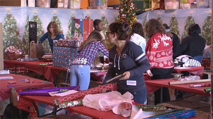 A group of people wrapped presents for kids fighting cancer in Chandler. (Source: 3TV/CBS 5)