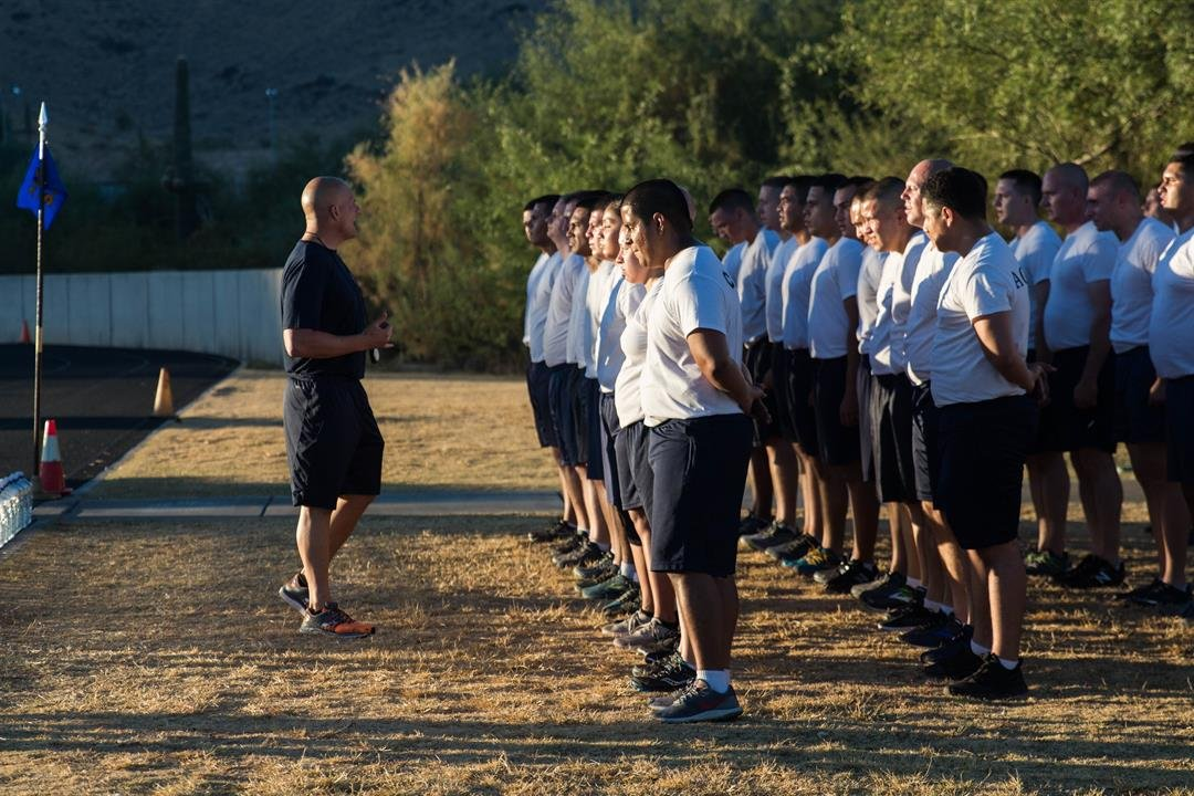 Recruits stand at attention after completing a run during their 16-week training at the Arizona Law Enforcement Academy. (Photo by Tynin Fries/Cronkite News