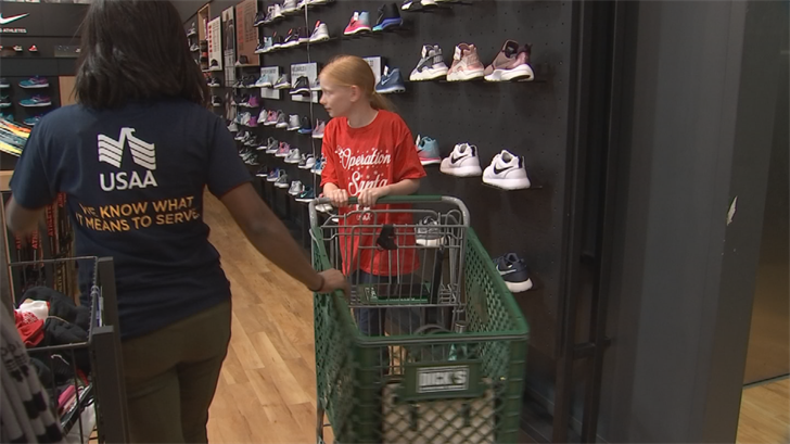 Two dozen Phoenix-area kids got the chance to go on a holiday shopping spree, thanks in part to Fiesta Bowl Charities. (Source: 3TV/CBS 5)