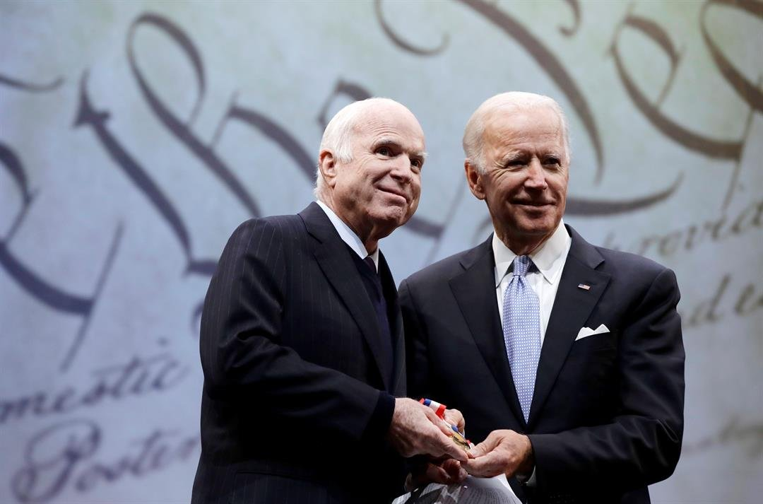 Sen. John McCain, R-Ariz., receives the Liberty Medal from Chair of the National Constitution Center's Board of Trustees, former Vice President Joe Biden, in Philadelphia, Monday, Oct. 16, 2017. (AP Photo/Matt Rourke)