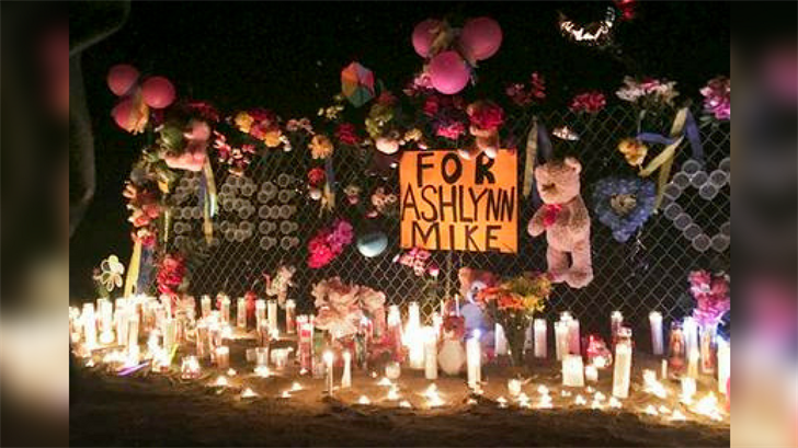 FILE - In this May 3, 2016 file photo, candles burn at a memorial for Ashlynne Mike, who was abducted and murdered, on the Navajo Nation southwest of Farmington, N.M. (Source: AP Photo/Mary Hudetz, File)