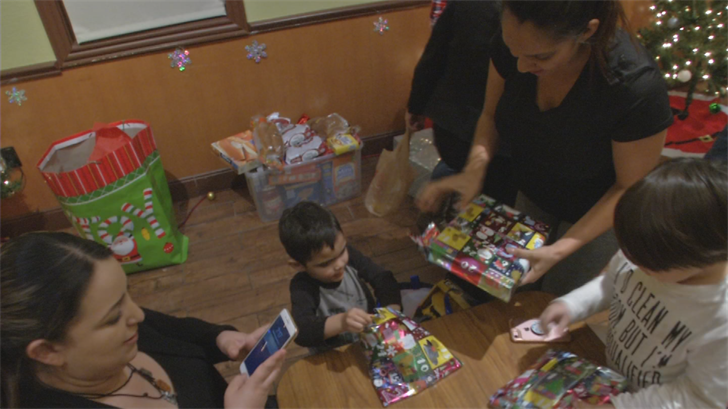 Kids from seven families had a Christmas to remember thanks to staff at a Denny's and the community. (Source: 3TV/CBS 5)