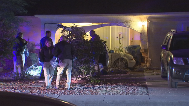 The driver crashed into the pillar of a home near 54th Lane and Hubbell Street. After impact, DPS said the driver bailed from the vehicle and fled on foot. (Source: 3TV/CBS 5)