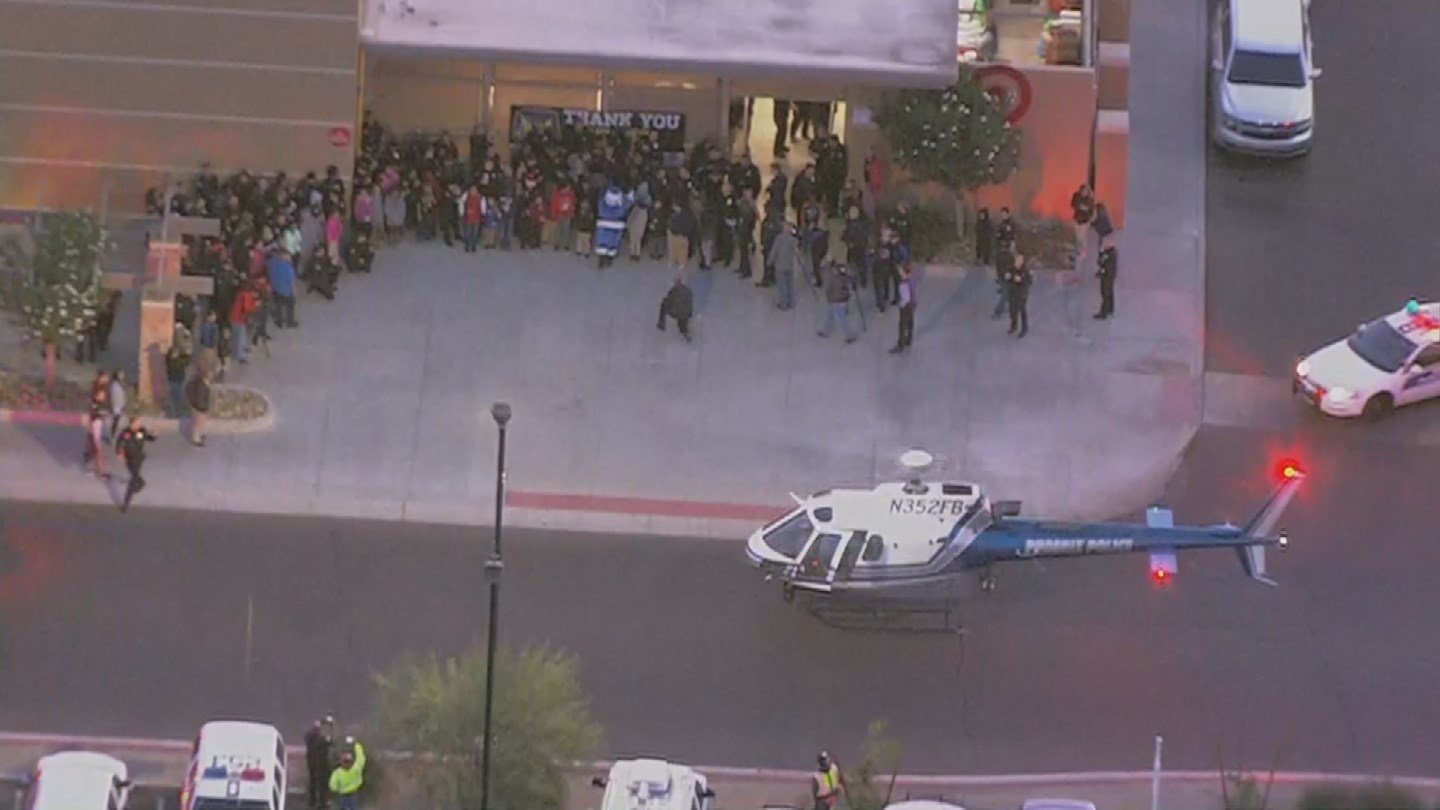 Santa arrives in a Phoenix police helicopter for 'Shop With A Cop' event at Target in Phoenix. (Source: 3TV/CBS 5)