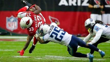 Arizona Cardinals running back Kerwynn Williams (33) gets upended by Tennessee Titans cornerback Adoree' Jackson (25) during the second half of an NFL football game, Sunday, Dec.10, 2017, in Glendale, Ariz. (Source: AP Photo/Rick Scuteri)