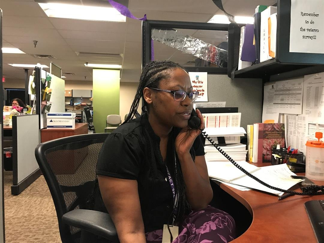 Lisa Clark, a clinical coordinator at Empact Suicide Prevention Center, talks to a caller who is discouraged about problems in his life. (Photo by Shawna Truong/ Cronkite News)