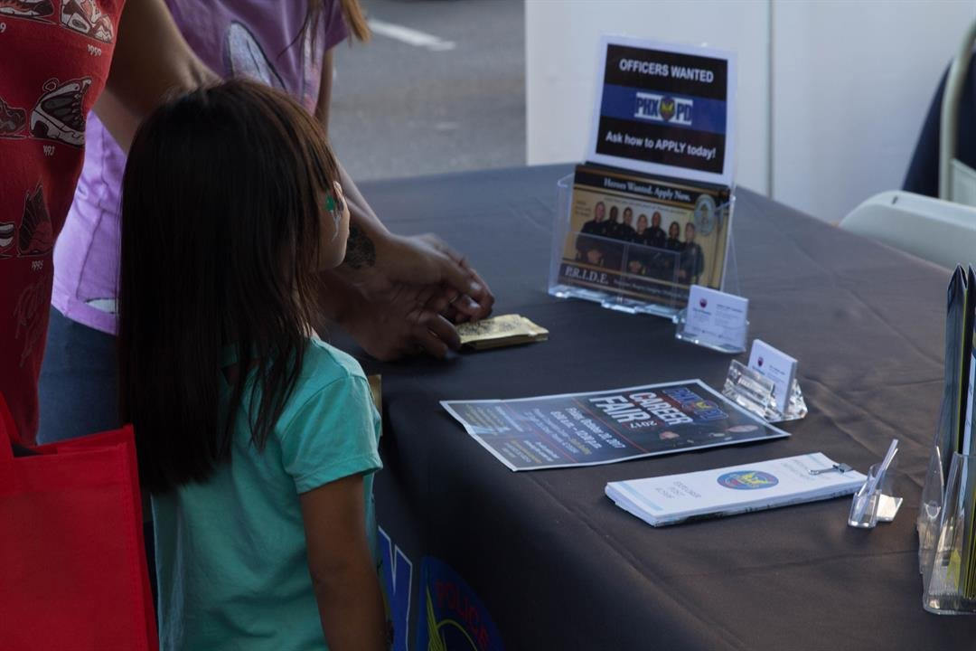 Police departments statewide have hundreds of job vacancies, and police officials hope career fairs will spark interest from younger and more diverse generations. (Photo by Kianna Gardner/Cronkite News)