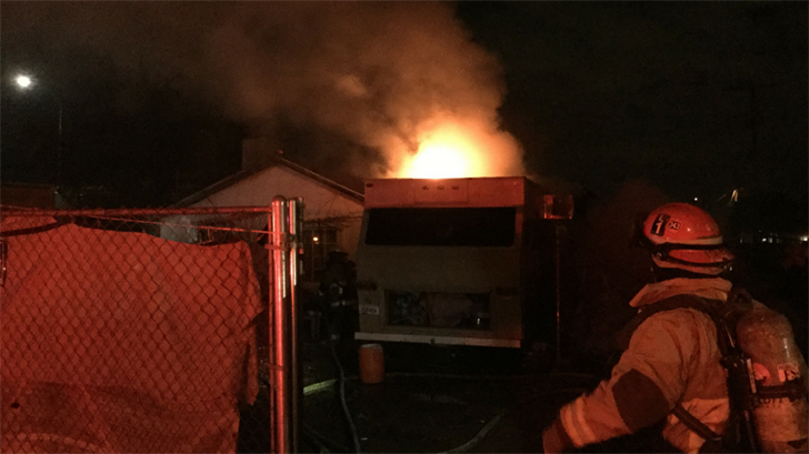 Phoenix firefighters prevented an RV fire from spreading to a nearby Phoenix home Sunday night. (Source: Phoenix fire)