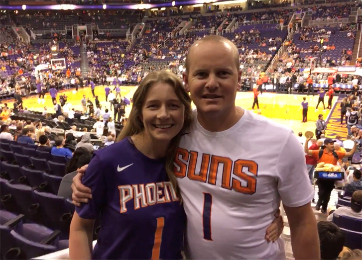 Lisa Barber (left) and Lee Greedus came from New Zealand to watch a Suns game. (Photo by Jamie Nish/Cronkite News)