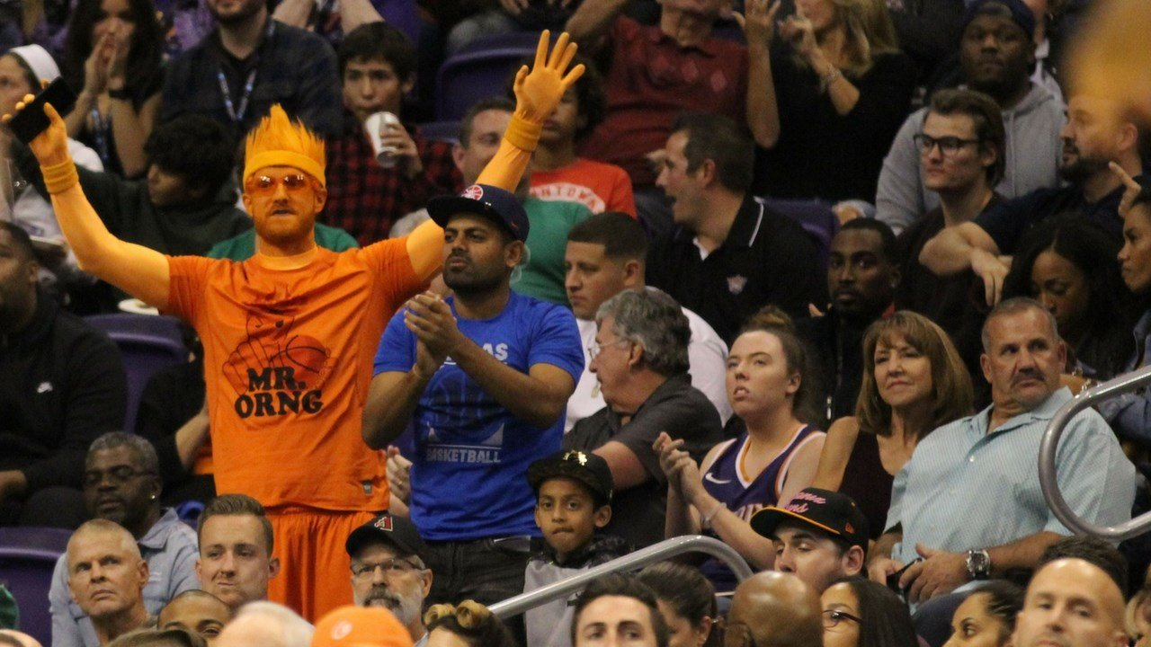 A Phoenix Suns fan reacts to a call on the court in the team's loss to the Houston Rockets at Talking Stick Resort Arena recently. (Photo by Jamie Nish/ Cronkite News)