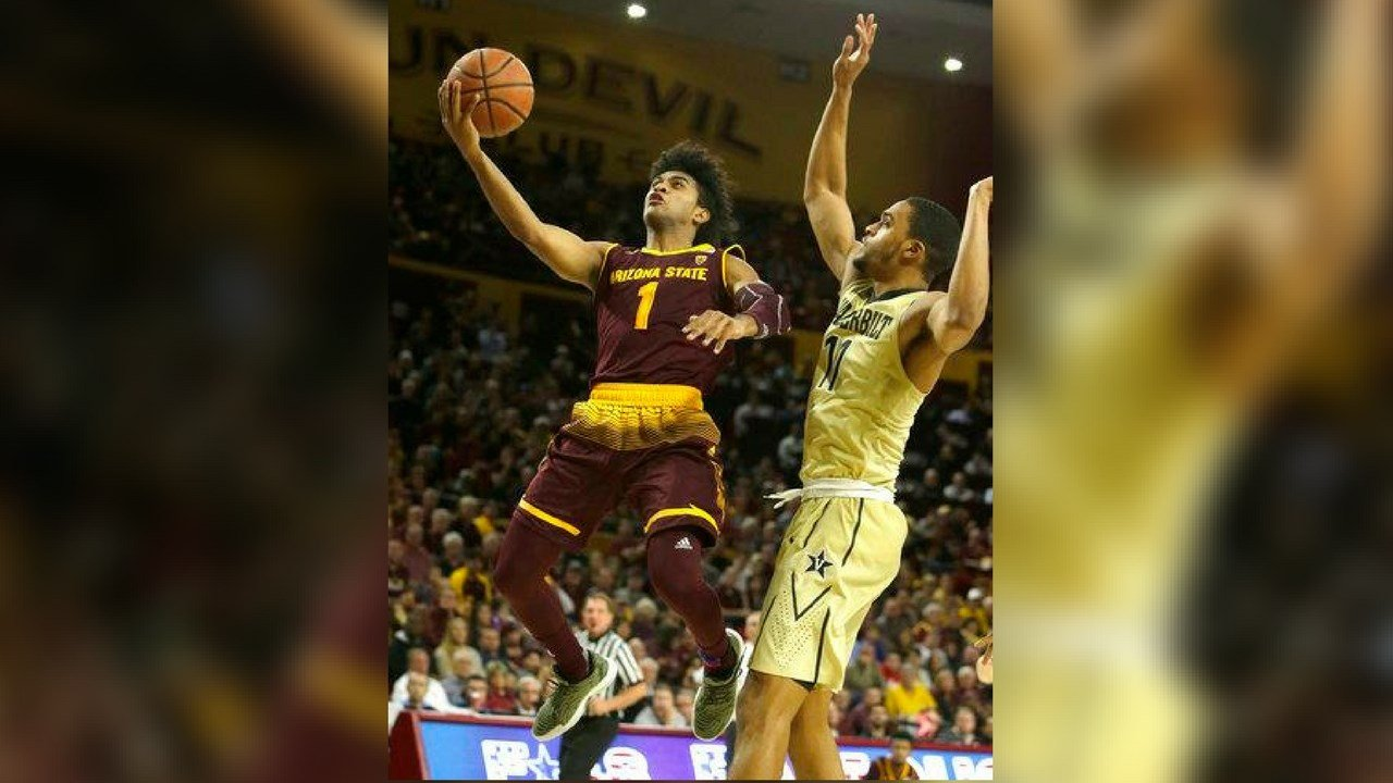 Arizona State guard Remy Martin (1) drives past Vanderbilt forward Jeff Roberson (11) in the second half during an NCAA college basketball game, Sunday, Dec 17, 2017, in Tempe, Ariz. (AP Photo/Rick Scuteri)