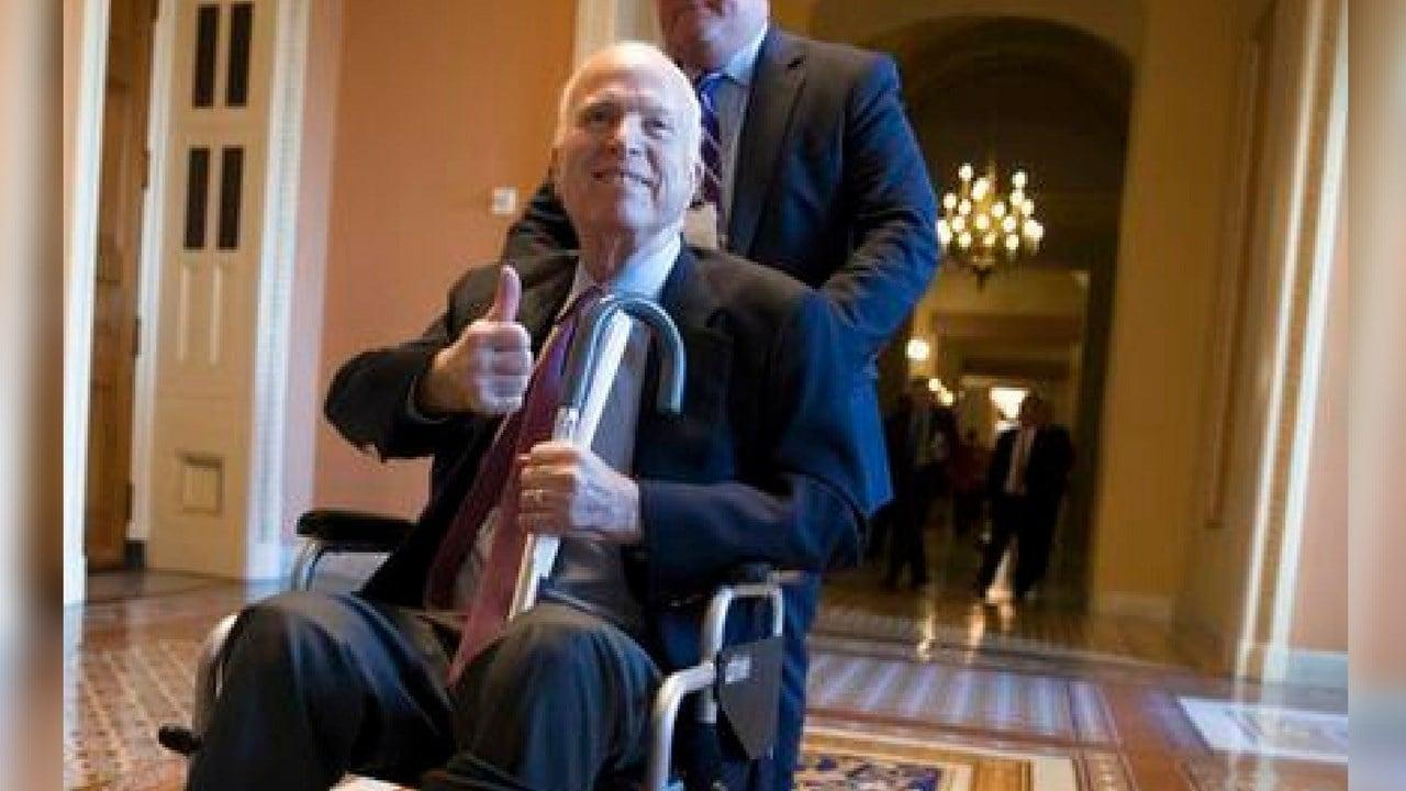 In this Dec. 1, 2017 file photo, Sen. John McCain, R-Ariz., leaves a closed-door session where Republican senators met on the GOP effort to overhaul the tax code, on Capitol Hill in Washington. (AP Photo/J. Scott Applewhite, File)