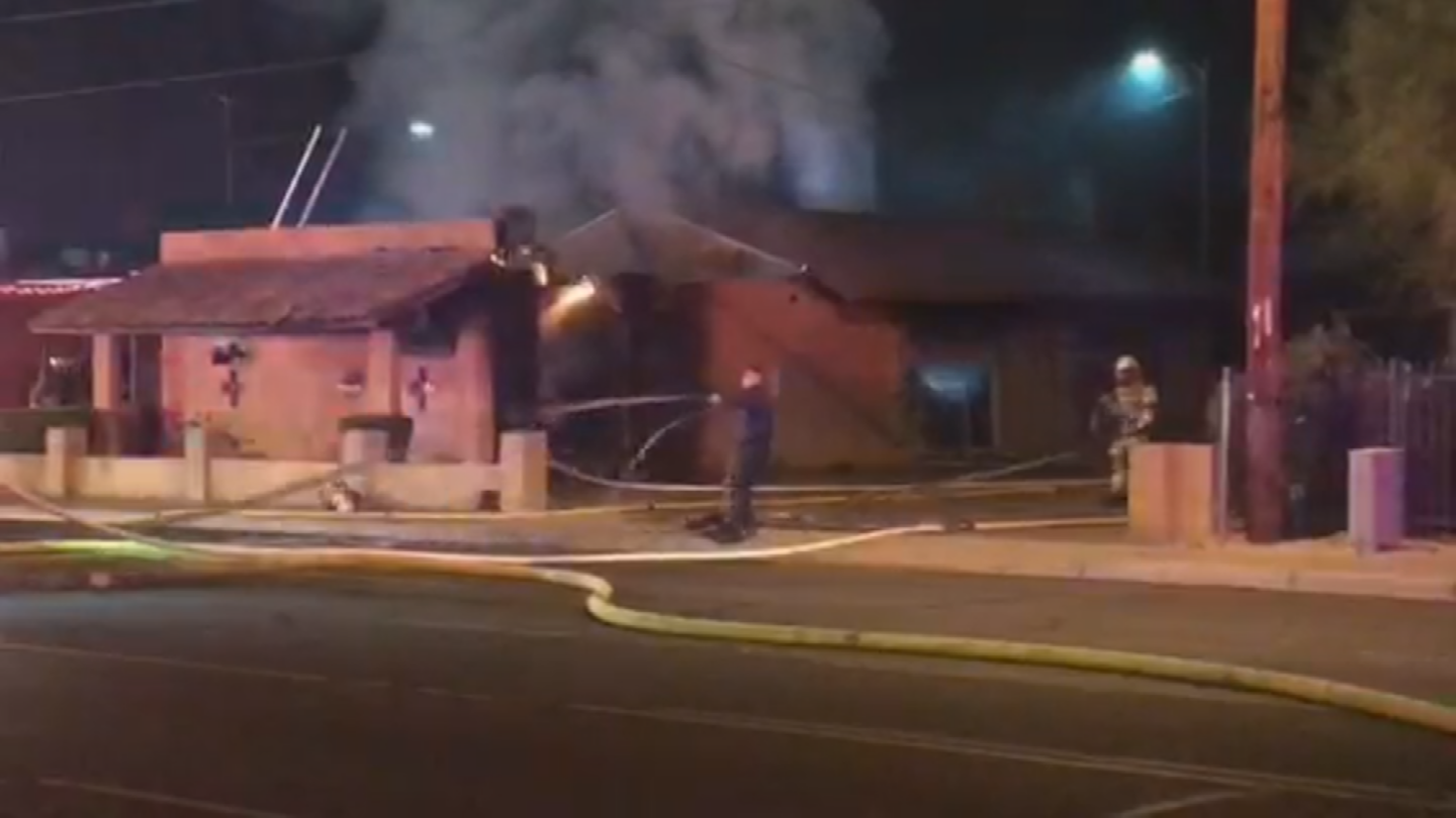 Almost 40 firefighters battled a first-alarm fire at atile and carpet business early Tuesday morning in Phoenix. (Source: 3TV/CBS 5)