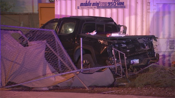 Two people were hurt after a truck rolled on the Loop 202 entrance ramp causing it to go through a fence in Tempe. (Source: 3TV/CBS 5)